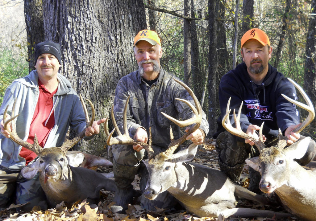 deer hunters with their harvest